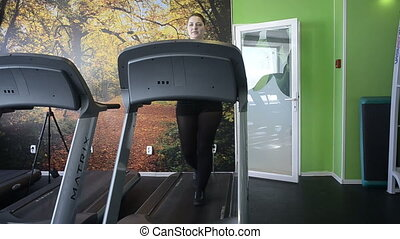 Woman on racetrack simulator - Woman does exercise on...