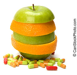 vitamins source - mixed sliced fruits and pills isolated on...