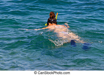 Snorkelling girl - Woman snorkelling in the clear waters of...