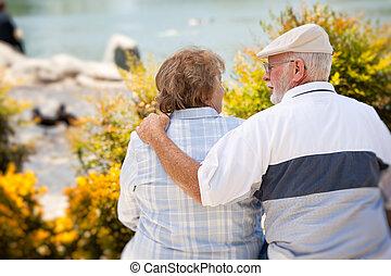 Happy Senior Couple in The Park - Happy Senior Couple...