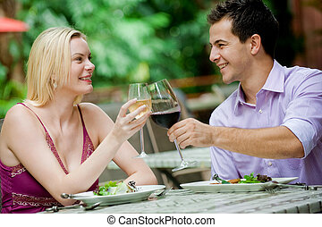 Couple Having Meal - An attractive caucasian couple having a...