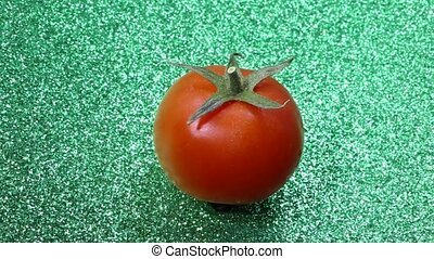 red tomato rotating - fresh red tomato rotating in the green...