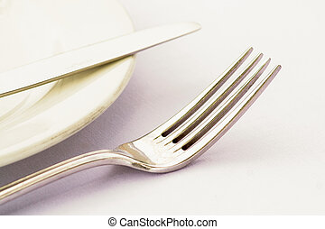 Fork and Knive - Cutlery on a side plate high key