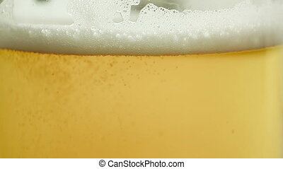 Close up view of pouring beer into a glass