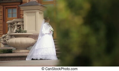 Beautiful bride and groom near house Full HD