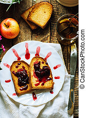 Toast with jam and cup of tea on old wooden table. Delicious...