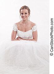 Attractive twenties caucasian blonde bride with happy...