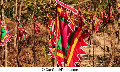 Line of Red Religious Buddha Banners Flap in Wind - closeup...