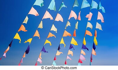 Closeup Garlands of Colourful Flags Sea Blue Sky - closeup...