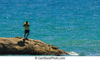 Guy Jumps from Rock into Azure Sea - MUI NE, BINH...