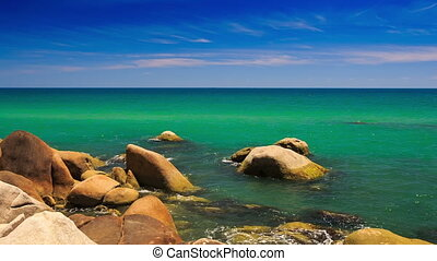 Rock Stony Beach Azure Sea Skyline - camera moves from round...