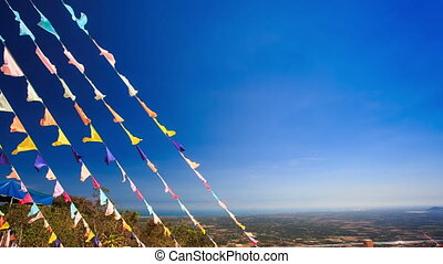 Garlands of Colourful Flags against Sea Blue Sky - wind...