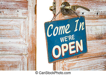 Come In Were Open on the wooden door open, isolated,...