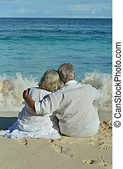 elderly couple rest at tropical beach - Happy elderly couple...