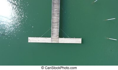 wooden landing stage green water aerial view