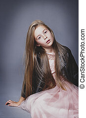Little girl posing like a fashion model - Young little girl...