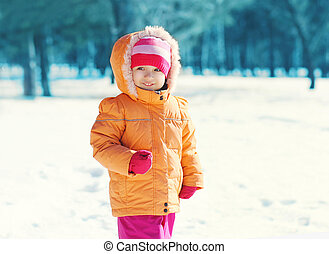 Portrait of little child looking away in winter day