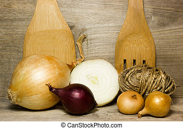 Onion on wooden background in the kitchen