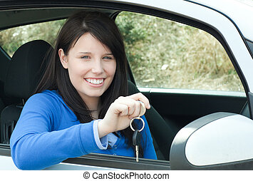 Girl sitting in her car with keys