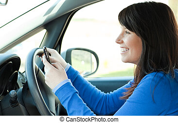 Jolly teen girl driving her car