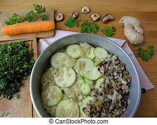 Cooking goutweed vegetables gratin, green organic food with...