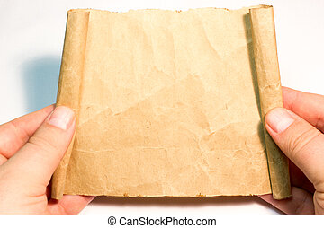 The sheet of parchment in hand on white background