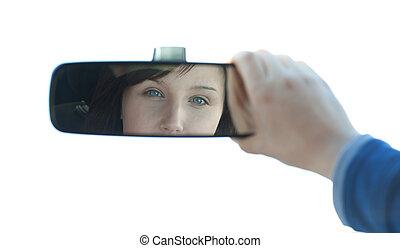 Brunette woman looking in the rear-view mirror - Brunette...