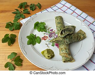 Goutweed omelet on plate - Cow parsley omelet on plate,...