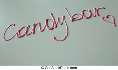 The inscription Candy Bar from the pink glaze.