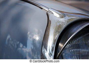 Retro styled image of a front of  blue classic car