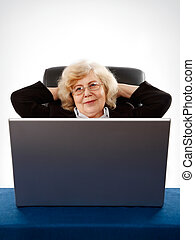 businesswoman sitting in armchair by the laptop