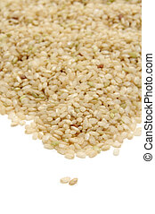 brown rice - closeup of a pile of brown rice isolated on a...