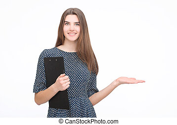 Woman in dress with tablet palms up on isolated background