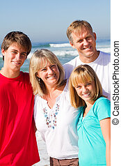 happy family - a happy family smiling on the beach together