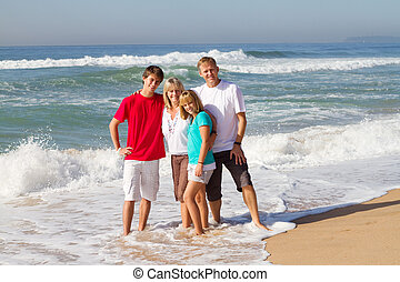 happy family portrait - portrait of a happy family posing on...