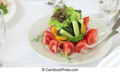 Fresh salad with cucumbers and tomatoes