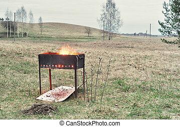 charcoal preparation to bake shashlik - brazier with burning...