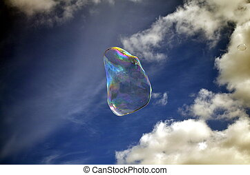Soap bubble on blue sky background