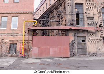 old sliding gates - Facade of a pink building wall with...