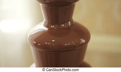 Chocolate fountain placed on a table in wedding day