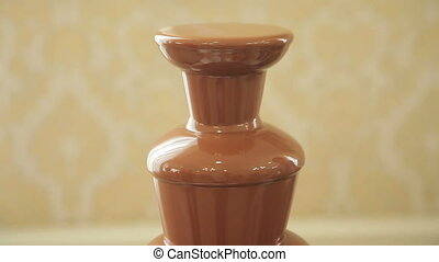 Chocolate fountain placed on a table
