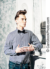 hairstyle with bang - Fashion studio shot of a handsome male...
