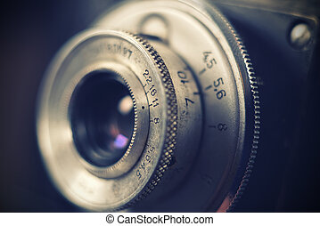 Old retro camera lens, close up Vintage effect