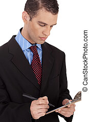 Closeup of a business man with notepad on a white background