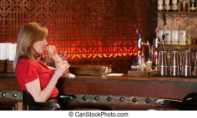 Couple Enjoying Drink In Bar man and a woman in a bar