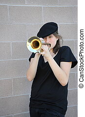 Female trumpet player - Female jazz trumpet player blowing...