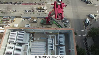Truck Crane Aerial Drone Footage - Huge truck crane lifting...