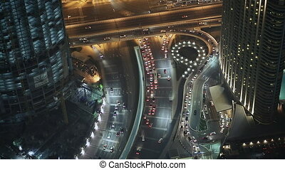 Night traffic. The view from the tallest building. Dubai.