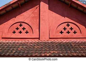 Old red brick gabled roof.
