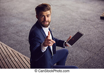 You can have it too! - A photo of young businessman in suit...